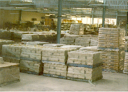The packs are stacked on pallets ready for despatch.